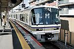 JR train arriving to a train station platform in Kyoto, Japan 2017