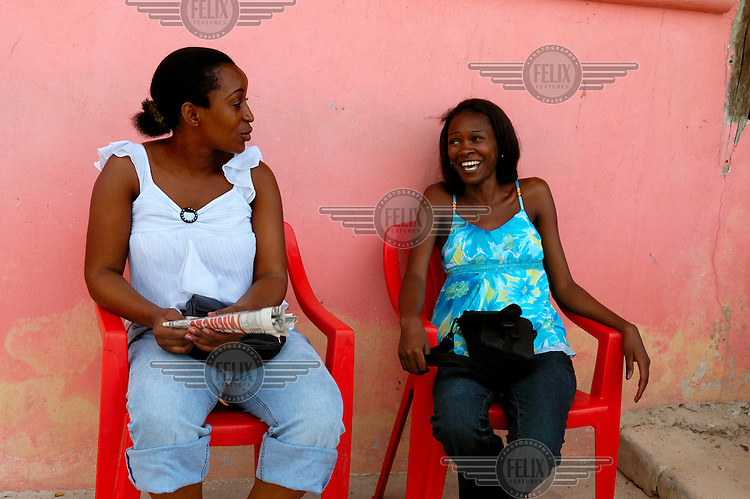 Young women at a bar on Coco Beach, which at the weekends is one of the most popular spots in the city.