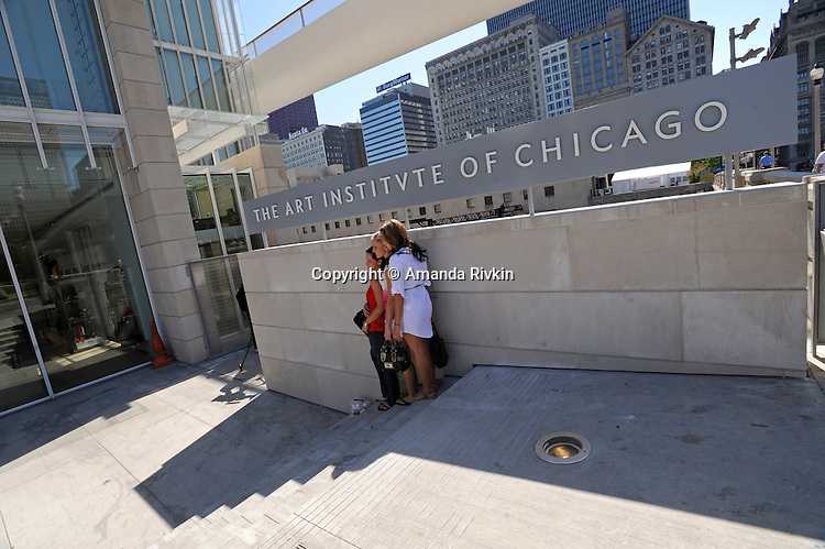 "Visitors pose for a photograph outside the recently unveiled Modern Wing of the Art Institute Chicago, designed by architect Renzo Piano on the first ""free Tuesday"" where admission costs nothing and is open to the public, in Chicago, Illinois on May 19, 2009."