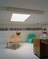 A plywood and a green cardboard chair by Stefan Diez in his jewellery designer wifes studio