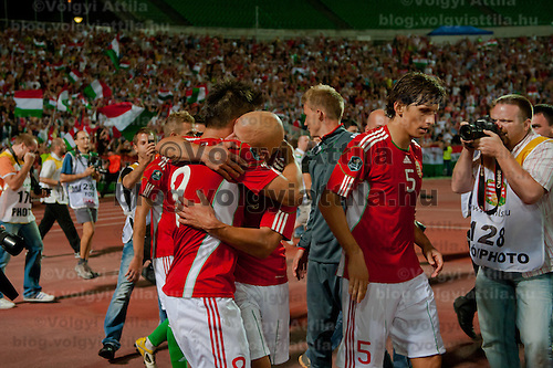 Members of the winning Hungarian team celebrate their victory during the UEFA EURO 2012 Group E qualifier Hungary playing against Sweden in Budapest, Hungary on September 02, 2011. ATTILA VOLGYI