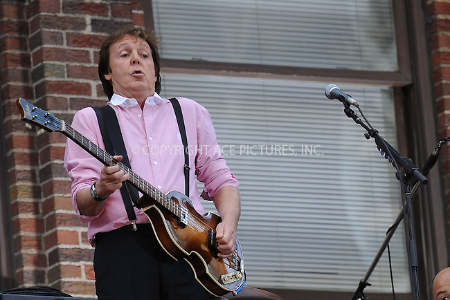 WWW.ACEPIXS.COM . . . . . ....July 15 2009, New York City....Musician Paul McCartney performed on the awning in front of the Ed Sullivan Theatre for the 'Late Show with David Letterman' on July 15 2009 in New York City....Please byline: KRISTIN CALLAHAN - ACEPIXS.COM.. . . . . . ..Ace Pictures, Inc:  ..tel: (212) 243 8787 or (646) 769 0430..e-mail: info@acepixs.com..web: http://www.acepixs.com