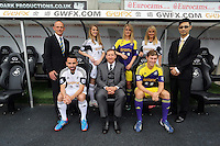 Pictured front L-R: Leon Britton with home kit, chairman Huw Jenkins and Ben Davies with Darren Vickers (L), Albert Sin (R) both of Goldenway sponsors  local female models. <br /> Re: Official launch of the 2013-2014 Swansea City Football Club kit launch, with sponsors Goldenway GWFX at the Liberty Stadium, Swansea, south Wales. Friday 28th of June 2013