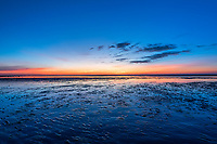 Sunset on tidal flats, Brewster, Cape Cod, Massachusetts, USA.