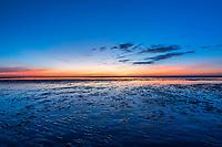 Sunset on tidal flats, Brewster, Cape Cod, Massachusetts, USA.