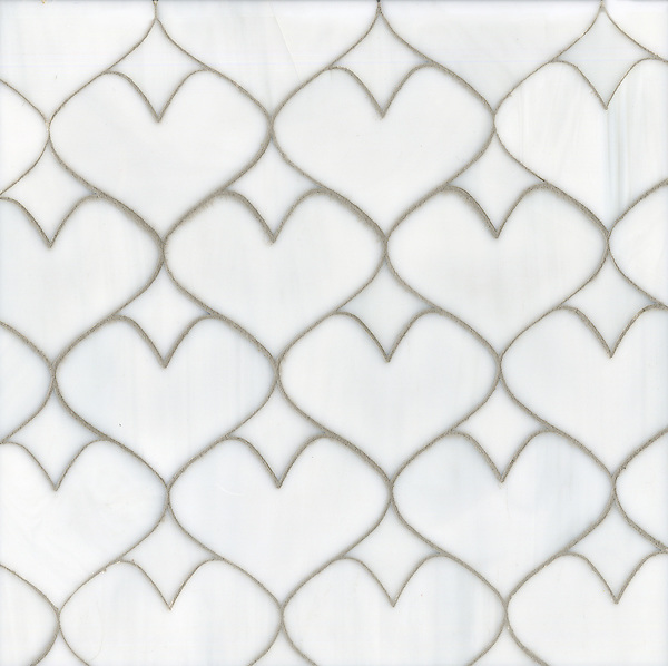 Hearts, a glass waterjet mosaic shown in Moonstone, is part of the Erin Adams Collection for New Ravenna.