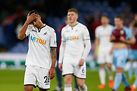 Kyle Naughton of Swansea City shows a look of dejection as he leaves the pitch at full time during the Premier League match between Burnley and Swansea City at Turf Moor, Burnley, England, UK. Saturday 18 November 2017