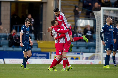 30th November 2019; Dens Park, Dundee, Scotland; Scottish Championship Football, Dundee Football Club versus Queen of the South; Stephen Dobbie of Queen of the South celebrates after scoring for 1-0 with Faissal El Bakhtaoui and Kevin Holt  - Editorial Use