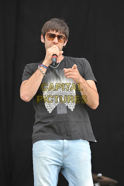 Example (Elliot John Gleave).Performs on during Day One of Wireless Festival, Hyde Park, London, England, UK, 1st July 2011..music live on stage concert half length  microphone  sunglasses  black t-shirt jeans singing hand finger pointing .CAP/MAR.© Martin Harris/Capital Pictures.