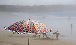 Umbrella and Beach on a Misty Morning in Maine, USA