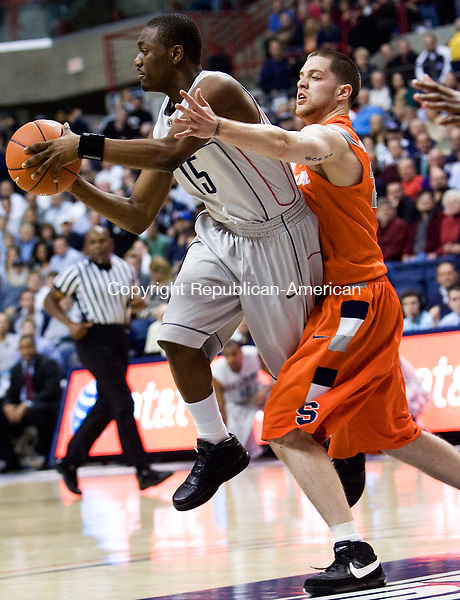 STORRS, CT - 11 FEBRUARY 2009 -021109JT08-<br /> UConn's Kemba Walker makes a pass while under pressure from Syracuse's Eric Devendorf during the first half of Wednesday's game at Gampel Pavilion. The Huskies won, 63-49.<br /> Josalee Thrift / Republican-American