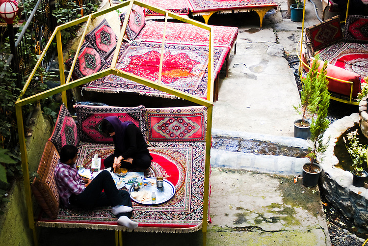 A Young Iranian couple is seen enjoying a lunch in the privacy of an empty restaurant in Darband, Northern Tehran.
