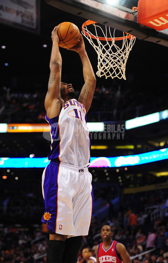 Dec. 28, 2011; Phoenix, AZ, USA; Phoenix Suns forward Markieff Morris goes up for a dunk against the Philadelphia 76ers at the US Airways Center. The 76ers defeated the Suns 103-83. Mandatory Credit: Mark J. Rebilas-USA TODAY Sports