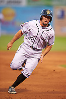 Jacksonville Suns third baseman Zack Cox (20) runs the bases during a game against the Chattanooga Lookouts on April 30, 2015 at AT&T Field in Chattanooga, Tennessee.  Jacksonville defeated Chattanooga 6-4.  (Mike Janes/Four Seam Images)