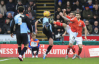 Jack Marriott of Luton Town challenges for the ball during the Sky Bet League 2 match between Wycombe Wanderers and Luton Town at Adams Park, High Wycombe, England on 6 February 2016. Photo by Liam Smith.