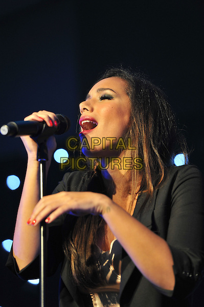 Leona Lewis.'Global Angels Awards', The Park Plaza Hotel, Westminster, London, England. 2nd December 2011..music on stage live concert gig performing half length hand  black jacket  microphone singing .CAP/MAR.© Martin Harris/Capital Pictures.