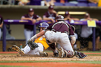 LSU Tigers shortstop Alex Bregman (8) slides home as Texas A&M catcher Michael Barash (5) tags him during the Southeastern Conference baseball game on April 25, 2015 at Alex Box Stadium in Baton Rouge, Louisiana. Texas A&M defeated LSU 6-2. (Andrew Woolley/Four Seam Images)