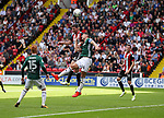 Chris Basham of Sheffield Utd tussles in the air with John Egan of Brentford during the English championship league match at Bramall Lane Stadium, Sheffield. Picture date 5th August 2017. Picture credit should read: Jamie Tyerman/Sportimage