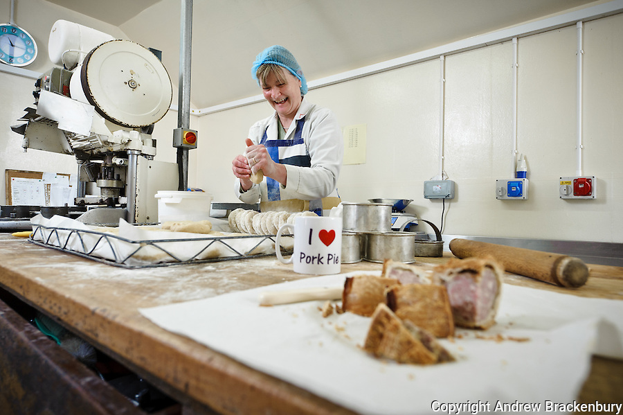 Lady making traditional Melton Mowbray pork pies at F Bailey and Sons butchers, Upper Broughton, Near Melton Mowbray, Leicestershire - Image commissioned by Good Food Magazine