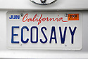 A close up of a 'ECOSAVY' (Eco Savvy) license plate on Toyota Prius hybrid. Millbrae, California, USA