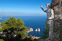Italy, Campania, Capri: View from Monte Solaro with Roman statue over Faraglioni rocks   Italien, Kampanien, Provinz Neapel, Capri: Blick vom Monte Solaro mit roemischer Statue zu den Faraglioni