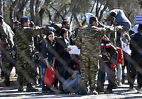 Pictured: Migrants as seen through the fence of the refugee camp Tuesday 23 February 2016<br /> Re: Migrants at a refugee camp in the Schisto area of Athens, Greece.