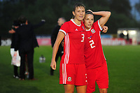 Gemma Evans of Wales Women's' and Loren Dykes of Wales Women's' at full time during the Women's International Friendly match between Wales and New Zealand at the Cardiff International Sports Stadium in Cardiff, Wales, UK. Tuesday 04 June, 2019