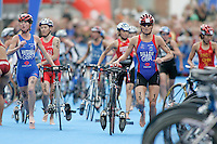 01 SEP 2007 - HAMBURG, GER - Andrea Whitcombe (GBR) and Michelle Dillon (GBR) race into transition - Elite Womens World Triathlon Championships. (PHOTO (C) NIGEL FARROW)