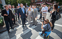 Republican Mayoral candidate Joe Lhota, center, blue tie, visits small businesses and campaigns on the 37th Avenue business district in the Jackson Heights neighborhood of Queens in New York on Friday, September 27, 2013.  Jackson Heights is a polyglot of ethnic groups ranging from Bangladeshis to South American to Indian to everyone else. (© Richard B. Levine)