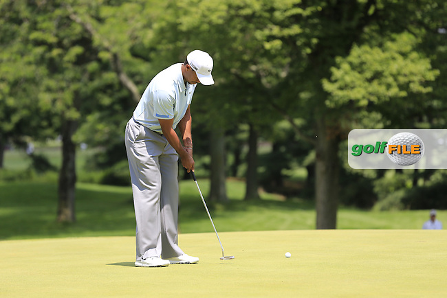 Tiger Woods (USA) putts on the 1st green during Saturday's Round 3 of the 2013 Bridgestone Invitational WGC tournament held at the Firestone Country Club, Akron, Ohio. 3rd August 2013.<br /> Picture: Eoin Clarke www.golffile.ie