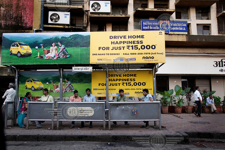 An advertisement on a bus stop for the Tata Nano, called the One Lakh car, and often billed as the world's cheapest car.  India, with its booming middle class, has an insatiable demand for small, compact cars, as people upgrade from motor bikes..