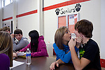 Cassie Runyon, 14, and boyfriend Kyle Gubanyar, 15, have been dating for five months and sit together at lunch in the cafeteria at Cardinal High School in Middlefield, Ohio.
