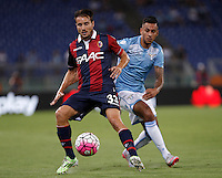 Calcio, Serie A: Lazio vs Bologna. Roma, stadio Olimpico, 22 agosto 2015.<br /> Bologna&rsquo;s Matteo Brighi, left, is chased by Lazio&rsquo;s Ricardo Kishna during the Italian Serie A football match between Lazio and Bologna at Rome's Olympic stadium, 22 August 2015.<br /> UPDATE IMAGES PRESS/Isabella Bonotto
