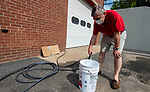 SOUTHBURY , CT-080620JS04—Southbury resident Edward Kossakowski, fills a bucket with non-potable water that is made available at the Southbury Volunteer Fire Department for residents still without power from Tropical Storm Isaias <br />  Jim Shannon Republican-American
