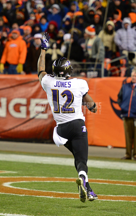 Jan 12, 2013; Denver, CO, USA; Baltimore Ravens wide receiver Jacoby Jones scores a touchdown in the fourth quarter against the Denver Broncos during the AFC divisional round playoff game at Sports Authority Field.  The Ravens defeated the Broncos 38-35 in double overtime. Mandatory Credit: Mark J. Rebilas-
