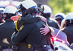 Carson City Sheriff's Deputies hug in front of the Sheriff's Office in Carson City, Nev., on Thursday, Aug. 20, 2015 at the beginning of the procession for Deputy Carl Howell, who was shot and killed early Saturday morning after responding to a domestic violence call. (Cathleen Allison/Las Vegas Review-Journal)