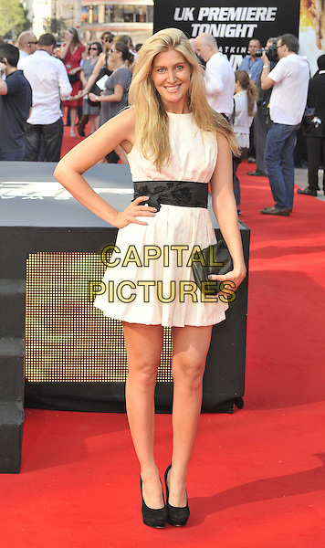 Francesca 'Cheska' Hull.UK Premiere of 'Johnny English Reborn' at the Empire, Leicester Square, London, England..October 2nd 2011.full length white dress sleeveless black clutch bag waistband hand on hip.CAP/CAN.©Can Nguyen/Capital Pictures.