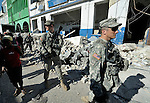 U.S. soldiers patrol amidst the rubble in the devastated center of Port-au-Prince, Haiti, which was ravaged by a January 12 earthquake.