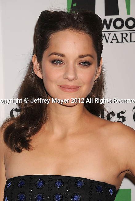 BEVERLY HILLS, CA - OCTOBER 22: Marion Cotillard arrives at the 16th Annual Hollywood Film Awards Gala presented by The Los Angeles Times held at The Beverly Hilton Hotel on October 22, 2012 in Beverly Hills, California.