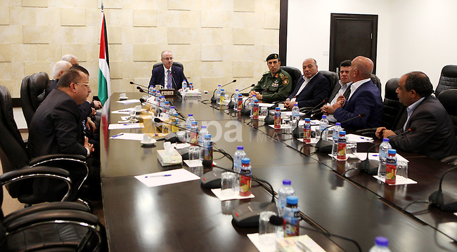 Palestinian Prime Minister Rami Hamdallah meets with Security chiefs, in the West Bank city of Ramallah on May 4, 2015. Photo by Prime Minister Offic