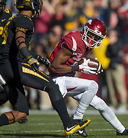 Hawgs Illustrated/BEN GOFF <br /> Jordan Jones, Arkansas wide receiver, evades Missouri defenders after catching a pass for 65 yards in the first quarter Friday, Nov. 24, 2017, at Reynolds Razorback Stadium in Fayetteville.