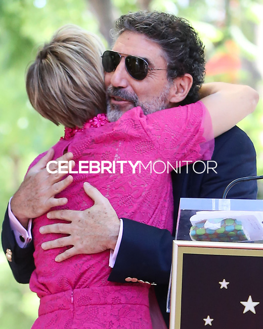HOLLYWOOD, LOS ANGELES, CA, USA - OCTOBER 29: Kaley Cuoco, Chuck Lorre at the ceremony honoring Kaley Cuoco with a star in the Hollywood Walk Of Fame on October 29, 2014 in Hollywood, Los Angeles, California, United States. (Photo by Xavier Collin/Celebrity Monitor)