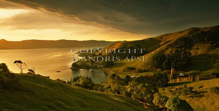 Dramatic sunrise. Portobello Bay. Otago Peninsula. New Zealand.