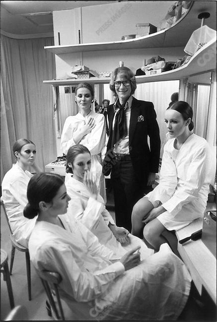 Yves Saint Laurent, fashion designer, with models backstage, Paris, France, January 1969.