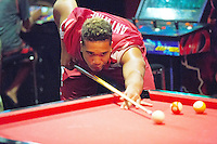 Photo by David Beach -Anthony Antwine of the Razorbacks play a little pool in the player's lounge during Razorback Football Media Day, Sunday, August 9, 2015.