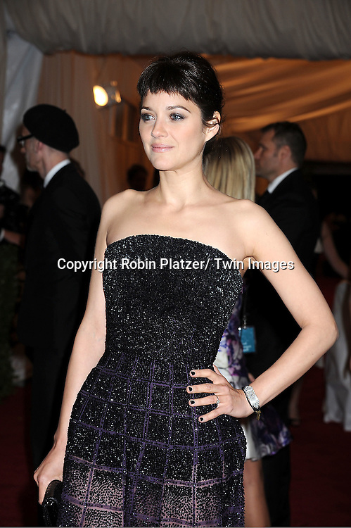 "Marion Cotillard attends the Costume Institute Gala Benefit celebrating ""Schiaparelli and Prada: Impossible Conversations"".an exhibition at the Metropolitan Museum of Art in New York City on May 7, 2012."