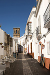Narrow historic village street of Arcos de la Frontera, Cadiz province, Spain