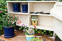 63821-203.15 Potting bench with containers and flowers in spring, Marion Co. IL