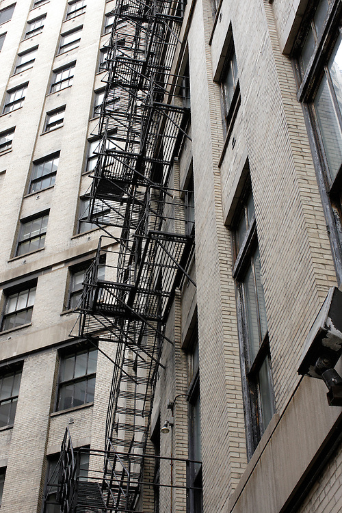 An old metal fire escape stands ready for use on the side of a building in Chicago, Illinois on August 5, 2008.