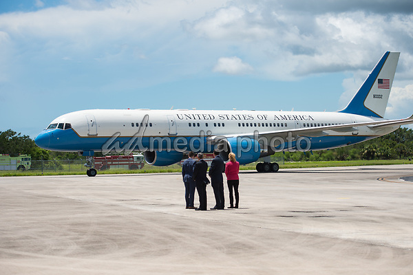 In this photo released by the National Aeronautics and Space Administration (NASA) United States Vice President Mike Pence arrives in Air Force Two as NASA Leadership looks on, at the Shuttle Landing Facility (SLF) to highlight innovations made in America and tour some of the public/private partnership work that is helping to transform Kennedy Space Center (KSC) into a multi-user spaceport on Thursday, July 6, 2017 in Cape Canaveral, Florida. Photo Credit: Aubrey Gemignani/NASA/CNP/AdMedia